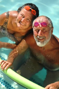 Senior couple swimming together